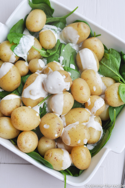 Baby potatoes and spinach being dressed
