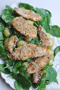 Sesame seed tossed chicken on spinach and potato