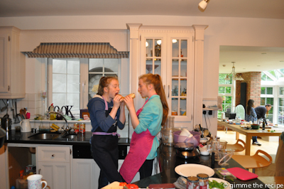 Eimear & Daire eating setup in background