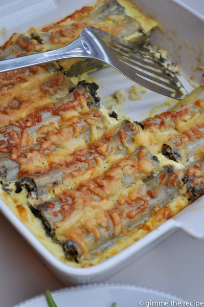 Cannelloni in dish with fish slice