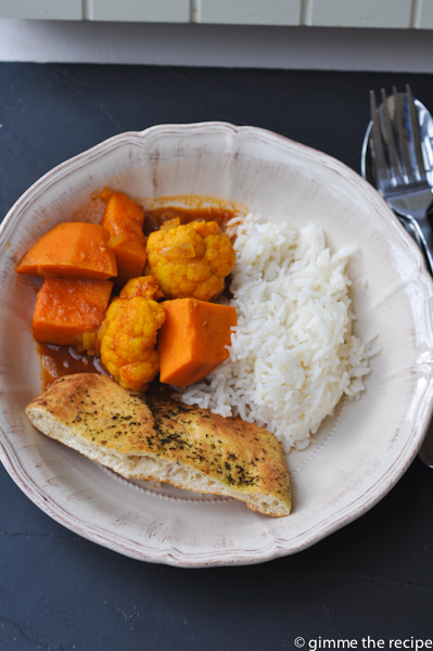 Cauliflower and sweet potato curry with naan bread and rice